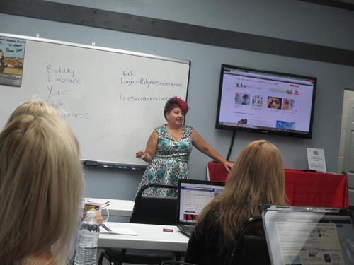 Sash teaching a Social Media Management Workshop for small business owners