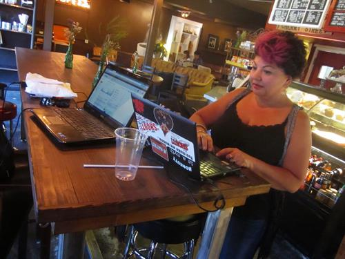 Sash working on the road. Our office is completely mobile so we can bring our services to you!