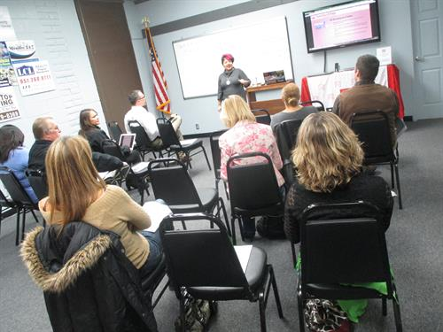 Sash teaching the Marketing 101 Workshop for small business owners