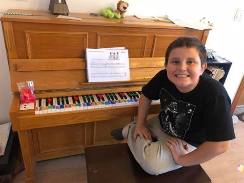 Jayden decorating the piano