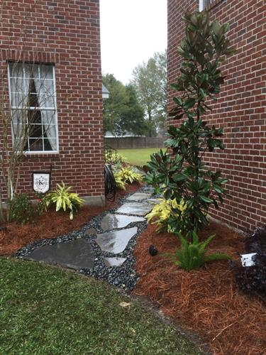 After flowerbeds and flagstone walkway installation.