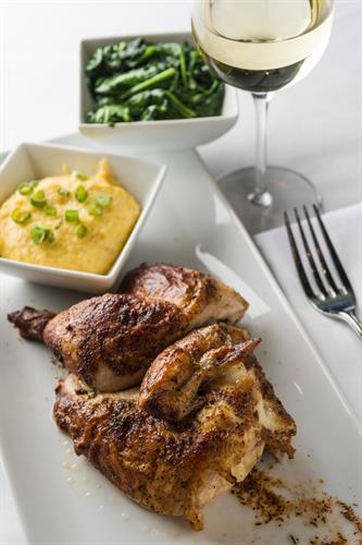 Zea Rotisserie Chicken with roasted corn grits.
