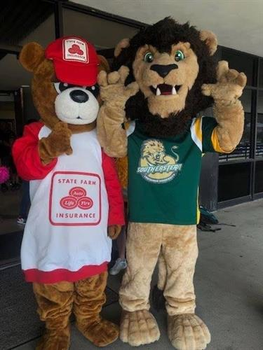 Good neighBEAR and Roomie the Lion a our backpack give away for teachers.