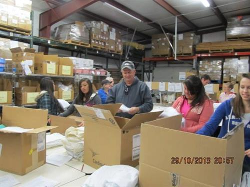 Volunteers pack boxes