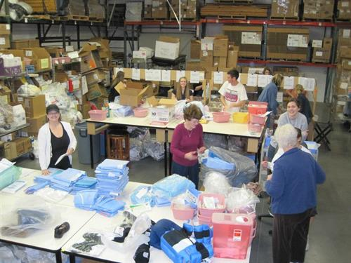Volunteers sorting supplies