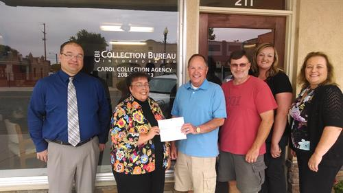 Payette Office making donation to Miracle League of Payette