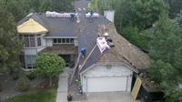 DURING PICTURE:  ROOF REPLACEMENT OF AN OLD WOODSHAKE ROOF