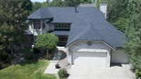 AFTER PICTURE: ROOF REPLACEMENT OF AN OLD WOODSHAKE ROOF /Owens Corning Duration Storm  COLOR: Onyx Black