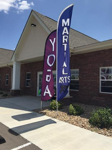 Yoga & Martial Arts Flags by our front Door: Aspire Enrichment Center