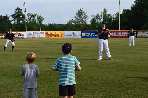 Saturday Games: Pregame toss -  Kids play catch with players before the game!