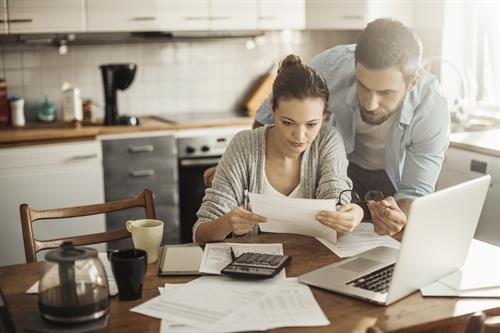 Gallery Image couple_in_kitchen_going_over_paperwork.jpg