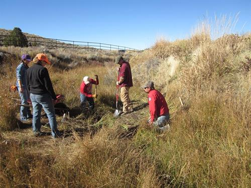 Creating pools to increase trout habitat.