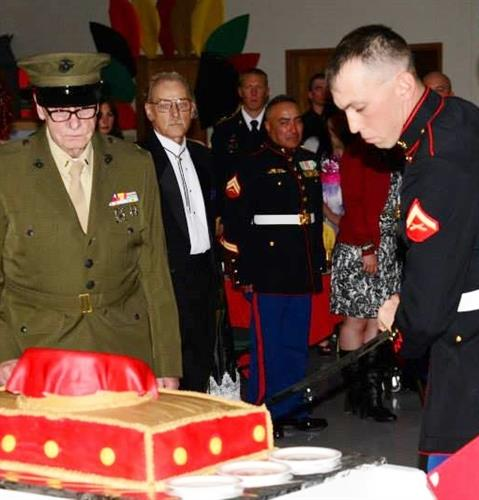 Oldest and Youngest Marines cut the Ceremonial Birthday Cake