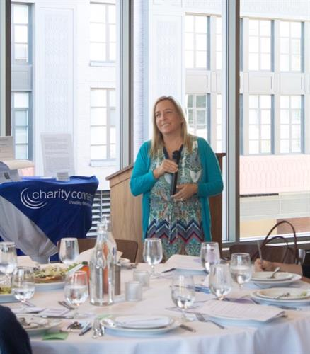 Cristin speaking at the Women Business Owners of Montgomery County September luncheon.