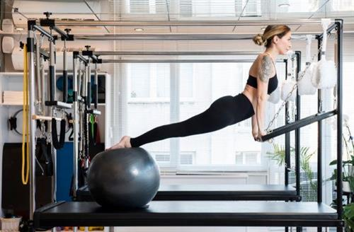 Back alignment Cadillac Pilates strength exercises