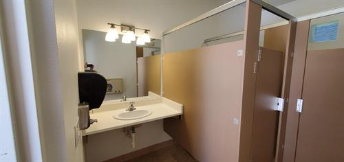 Another after shot - brand new partition wall stalls, vanity light, hand soap dispenser (new mirror, grab bars, toilet paper holders installed in stalls)