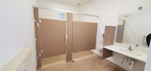 The other pool bathroom with new stall walls up