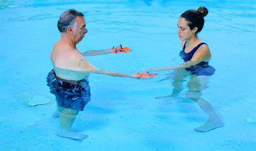 Kristina Vaughn, DPT leading one of her patients in our aquatic therapy program