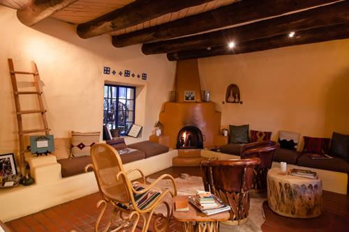 The Inn's living room and original Kiva wood-burning fireplace.