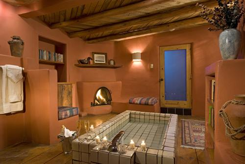 Puerta Rosa's sunken bathtub and cozy Kiva fireplace ~ also has a private sauna !