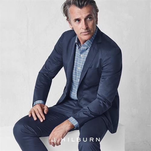 Storm Blue Cotton Suit $745, Navy/Aqua Mini Gingham Custom Shirt $135, Allen Edmonds Navy Suede Nomad Chukka $325