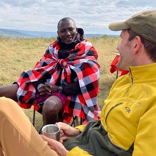 Guides in Africa often become friends - sharing a cup of tea in Kenya's Maasai Mara.