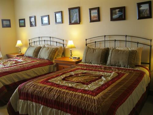DH home bedroom 4 with 2 queen size beds