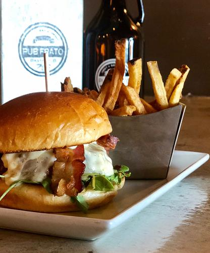 Pub Burger:  creekstone farms burger + arugula + onion jam + brie + bacon + rosemary aioli + brioche