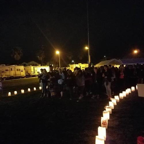 Luminaries, honoring those affected and remembering those lost, light our way as we walk throughout the night.