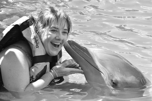 Sonee swimming with dolphins in Mexico on a NCL cruise