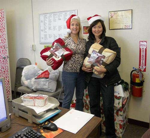 Carol making a delivery for our Be a Santa to a Senior program