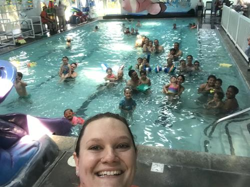 Assistant Manager Abby in a selfie with all our awesome attendees at our annual Open House
