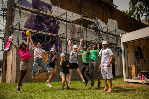 The team behind the James Pate' Avondale Heroes mural at 3371 Reading Road. Photo by Carlynne Welch.
