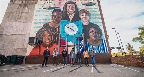 The team behind the ArtWork's 200th mural, Time Saved vs. Time Served, at 235 W. Court Street. Photo by Louis Rideout.