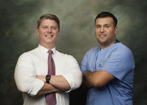Proud of our veterans, Dr. Thompson and Mario Colecio, Implant Coordinator and Surgical Tech