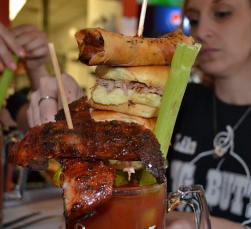 World famous MEGA BLOODY MARY!  24 oz handcrafted bloody mary with a splash of Samuel Adams Boston Lager and topped with a tasting of our famous smoked meats