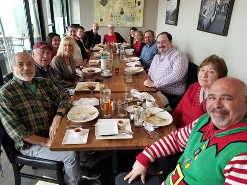 Our board members and staff at our holiday lunch.