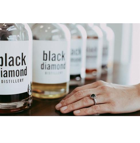 David proposed with a custom black diamond engagement, becoming part of their distillery journey even before they knew it!