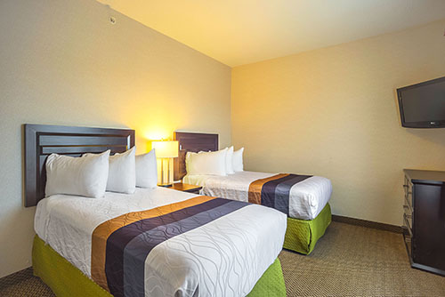 Bring the whole family along and enjoy a separate room with double beds in our family suite.