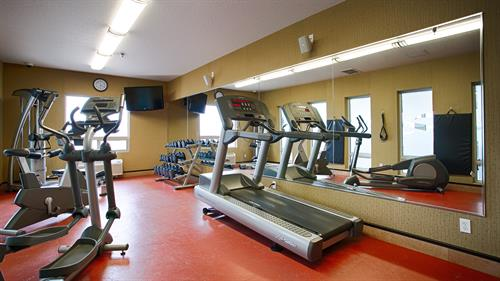 Our 24-hour exercise facility is equipped with weights and a treadmill for our guests to keep up with their fitness routine away from home.
