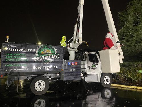 Helping Santa light the tree
