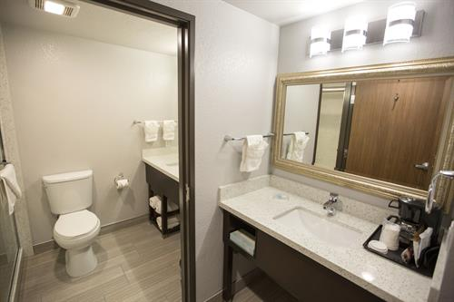 Convenient for guests sharing a room: two vanity sink areas!