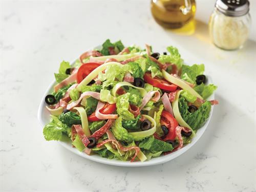 Antipasto salad - Fresh cut lettuce blend, ham, salami, cheese, black olives and sliced tomatoes