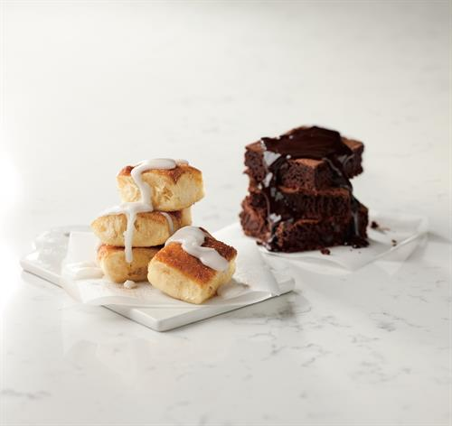 Cinnasquares - Fresh-baked, buttery pastry topped with cinnamon and sugar, served with a side of vanilla icing    Ghirardelli Double Chocolate Brownies