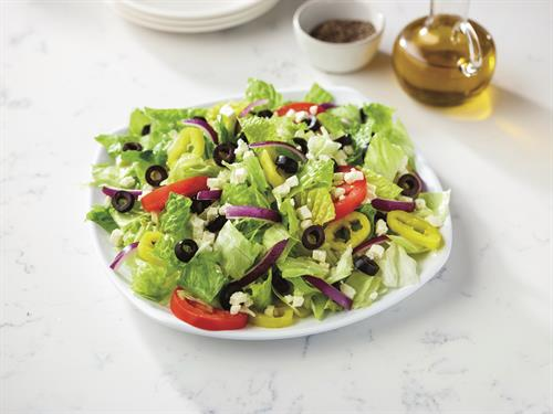 Greek Salad - Fresh-cut lettuce blend, feta cheese crumbles, black olives, sliced tomatoes onions, and banana peppers