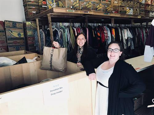 The team donating clothing to a charity, Rise Again. This organization takes donations to the local families in need.