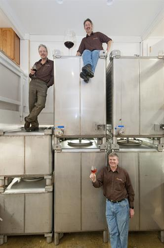Founders Bob Manley, Chuck Lawrence, and Ken Hardcastle in the cellar