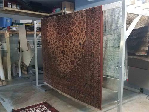 Cleaned rugs hung to be dry in our climate controlled room