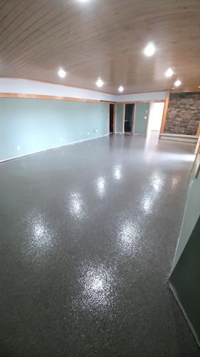An epoxy floor system with a marble flake color floor system completed for this basement renovation project