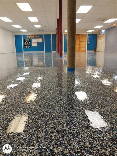 TTCC the Community Center in Bristol NH upgraded their community room to a beautiful blue flake epoxy floor system that will serve this community for many years with little maintenance.